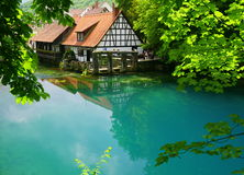 Blaubeuren. The so-called Blue Pot (Blautopf) in the German town of Blaubeuren is a deep hole with several springs Royalty Free Stock Photos
