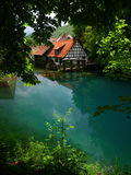 Blaubeuren. The so-called Blue Pot (Blautopf) in the German town of Blaubeuren is a deep hole with several springs Stock Image