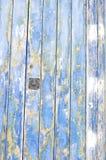 Blaue alte Tür der hölzernen Beschaffenheit Stockfoto