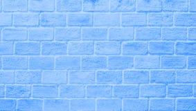 Blaue Backsteinmauer für Beschaffenheit Stockfotografie
