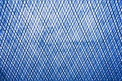 Blaue Beschaffenheit aus Draht heraus oder steeckmetall als Hintergrund mit orange Tönung Stockbild