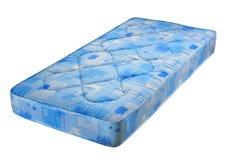 Blaue Bettmatratze Stockfoto