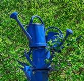 Blaue Bewässerungsdosen Lizenzfreies Stockfoto