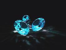 Blaue Diamanten mit schwarzem Hintergrund Stockfotografie