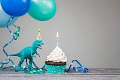 Blaue Dinosaurier-Geburtstagsfeier lizenzfreies stockbild