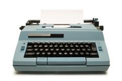 Blaue elektrische Schreibmaschine auf Weiß Lizenzfreie Stockfotografie