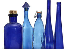 Blaue Flaschenansammlung der Weinlese Stockfoto