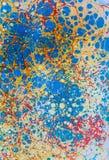 Blaue gelbe rote Papierpunkte Ebru Lizenzfreie Stockbilder