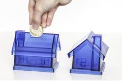 Blaue Geldkästen - Haus Lizenzfreie Stockfotos
