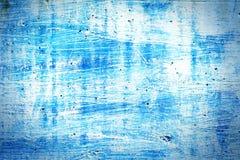 Blaue getragene Pflasterkleber-Wandbeschaffenheit Stockfoto