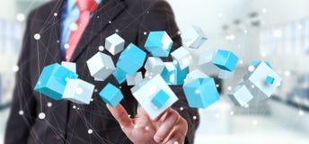 Blaue glänzende Wiedergabe des Würfels 3D des rührenden Fliegens des Geschäftsmannes Stockbild