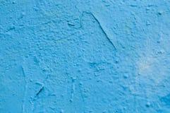 Blaue Graffiti auf der Wandbeschaffenheit Lizenzfreie Stockfotografie