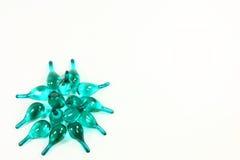 Blaue klare Kapseln stockfotos
