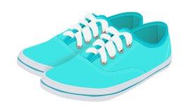 Blaue laufende Schuhe Stockfotografie