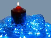 Blaue LED und die Kerze Stockbilder