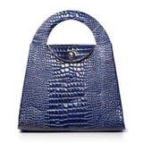 Blaue lederne weibliche Luxustasche Stockbilder