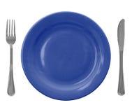 Blaue leere Platte mit Gabel und Messer Lizenzfreies Stockfoto