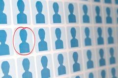 Blaue Leute mit einem Anwärter ausgewählt Stockfotografie