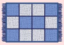 Blaue Matte mit Franse Rechteckige Wolldecke in der Zelle lizenzfreie abbildung