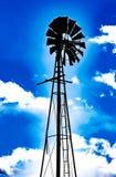 Blaue Neonwindmühle - bunt, kreativ, artsy und abstrakt lizenzfreie stockbilder