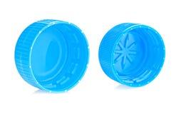 Blaue Plastikflaschenkapseln Stockfotos