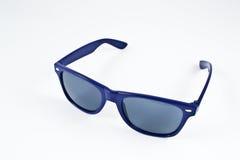 Blaue Plastiksonnenbrillen Lizenzfreie Stockfotos