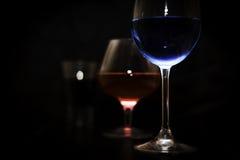 Blaue, rote, schwarze Gläser Lizenzfreie Stockbilder