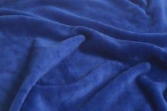 Blaue Samtgewebe-Hintergrundbeschaffenheit Lizenzfreie Stockbilder