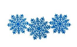 Blaue Schneeflocken lokalisiert Stockbild