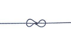 Blaue Schnur oder Schnur gebunden in einem Bogen lokalisiert auf weißem Hintergrund Lizenzfreies Stockbild