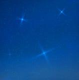 Blaue skyes Abend des Vektors mit Sternen Stockbild