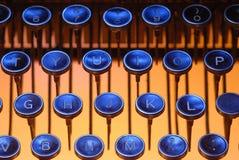Blaue Tasten auf Orange Stockbild