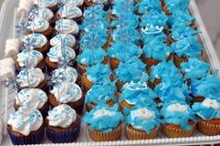 Blaue Themakleine kuchen Stockfotografie