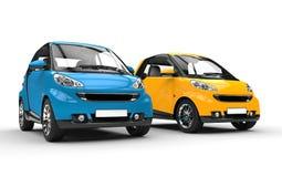 Blaue und gelbe kleine Autos Lizenzfreie Stockfotos