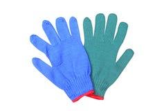 Blaue und grüne Handschuhe lokalisiert auf weißem Hintergrund stockfotos