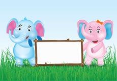 Blaue und rosa nette Elefant-Karikatur mit leerem Brett stockfotografie