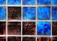 Blaue und rote Fliese Stockfotografie