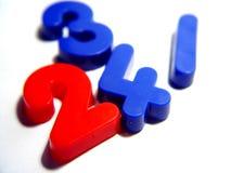 Blaue und rote Zahlen Stockfotografie