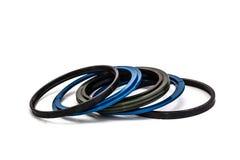Blaue und schwarze Öldichtung lokalisiert auf weißem Hintergrund Stockbild