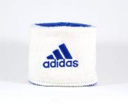 Blaue und weiße Adidas-Manschette - lokalisiert Stockbilder