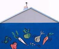 Blaue Wand mit Gemüsekunst Lizenzfreies Stockfoto