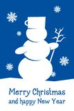 Blaue Weihnachtskarte mit Schneemann Stockbild