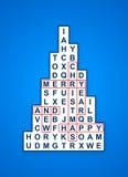 Blaue Weihnachtskreuzwort-Baumkarte Stockbild