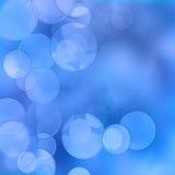 Blauer bokeh Auszugs-Leuchtehintergrund Stockbild