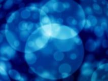 Blauer bokeh Auszugs-Leuchtehintergrund Stockfotos