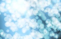 Blauer bokeh Hintergrund Lizenzfreie Stockfotos