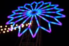 Blauer bokeh Hintergrund mit Licht wie Stern Stockfotografie