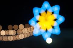 Blauer bokeh Hintergrund mit Licht wie Stern Lizenzfreie Stockfotos
