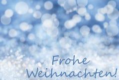 Blauer Bokeh-Hintergrund, Schnee, Frohe Weihnachten bedeutet frohe Weihnachten Stockbild