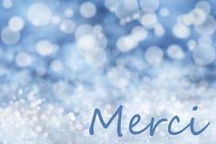 Blauer Bokeh-Weihnachtshintergrund, Schnee, Merci-Durchschnitte danken Ihnen Lizenzfreie Stockfotografie